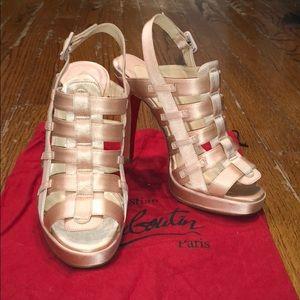 Light pink Christian Louboutin satin caged heels